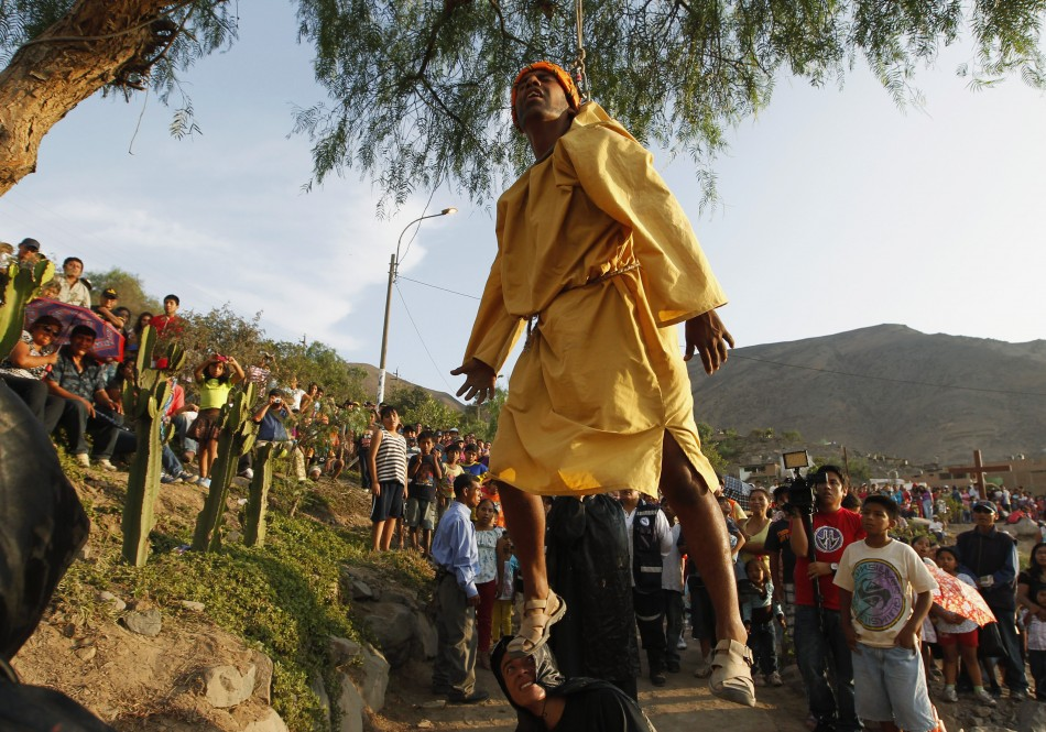 A penitent dressed as Judas is suspended from a tree in a re-enactment of the crucifixion of Jesus Christ on Good Friday in Comas, northern Lima, April 6, 2012.