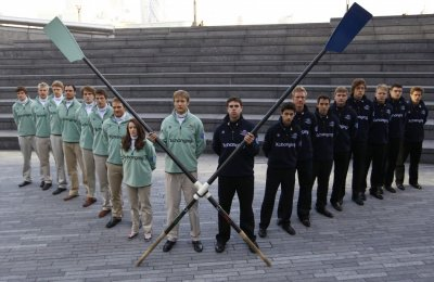 The Cambridge and Oxford boat crews pose for a photograph outside City Hall in London