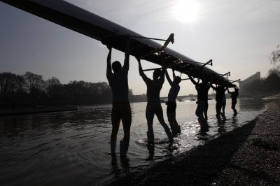 The Cambridge University rowing crew prepare for a training session on the River Thames in London