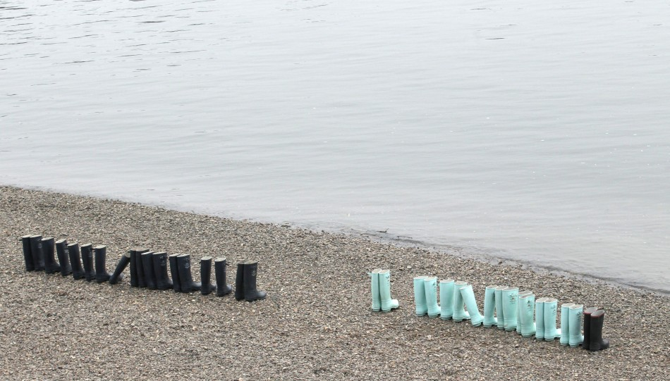 Wellington boots await the arrival of the Oxford and Cambridge rowing teams in the 157th Boat Race in London
