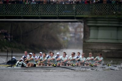 The Oxford and Cambridge rowing teams compete during the 157th Boat Race on the River Thames in London