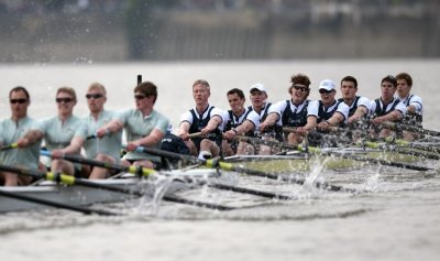 The Oxford rowing team pull past the Cambridge team during the 157th Boat Race on the River Thames in London