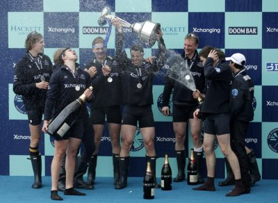 Oxford rowing team celebrate after winning against Cambridge in the 157th Boat Race in London