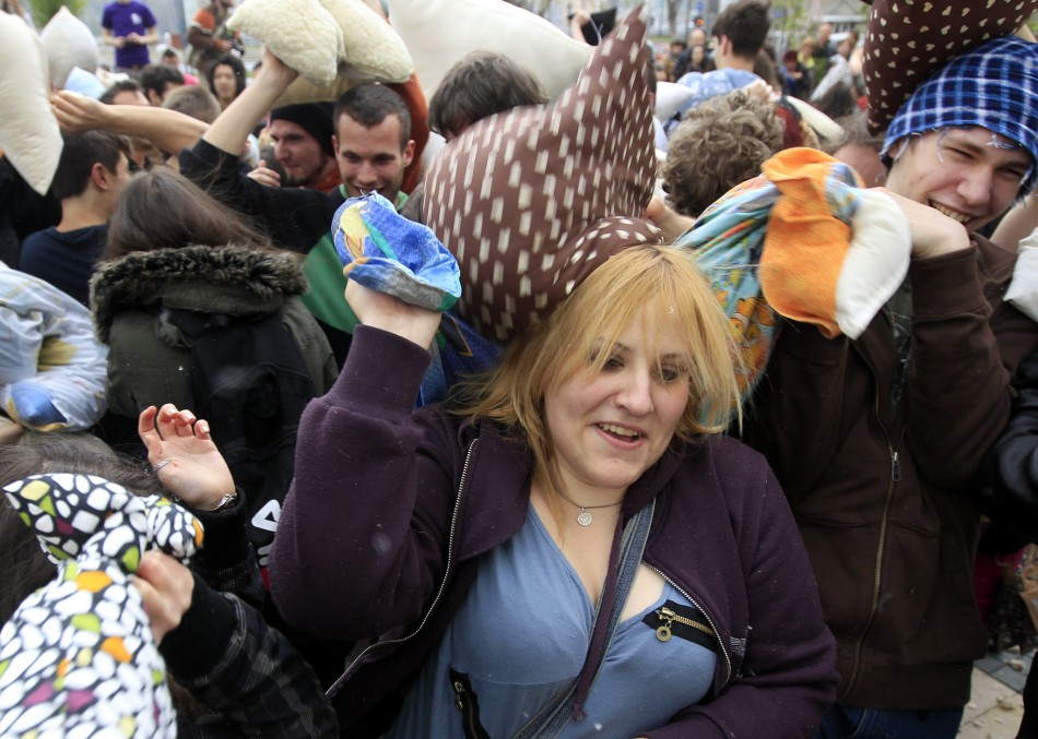 People fight with pillows during International Pillow Fight Day in Budapest