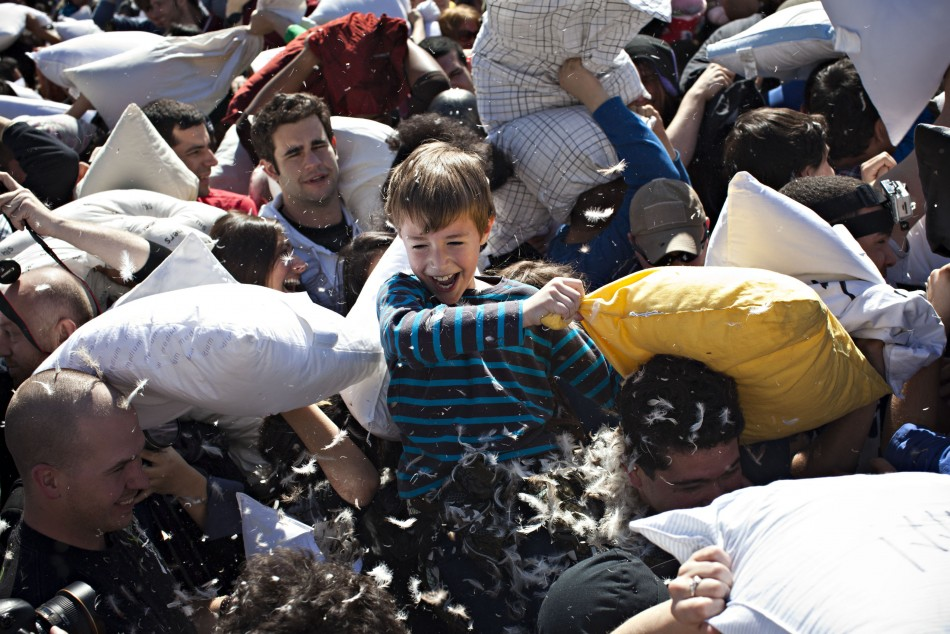 People participate in International Pillow Fight Day at Washington Square Park in New York