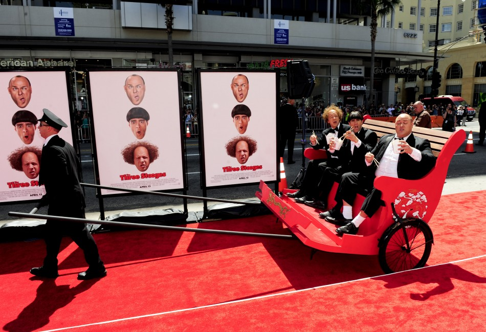 "Actors Hayes who plays Larry, Diamantopoulos who plays Moe and Sasso who plays Curly arrive in a rickshaw in character during the Hollywood premiere of ""The Three Stooges: The Movie"" in Los Angeles"