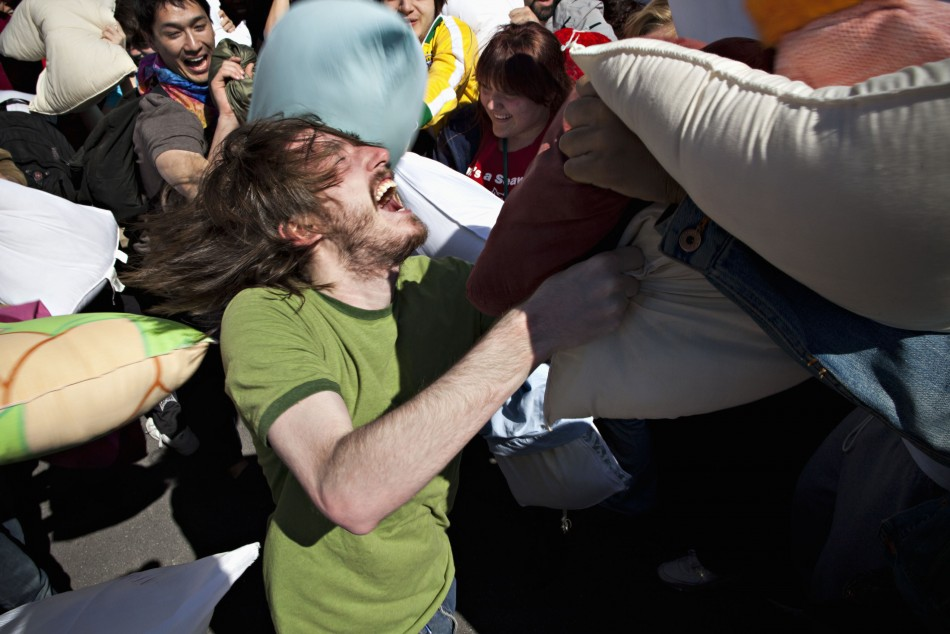 People participate in International Pillow Fight Day at Washington Square Park, in New York