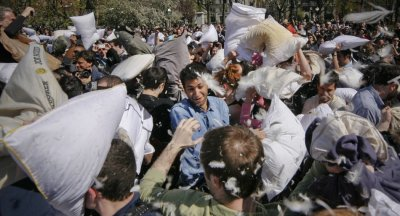 Hundreds participate in a mass pillow fight as part of the International Pillow Fight Day in New Yorks Washington Square Park