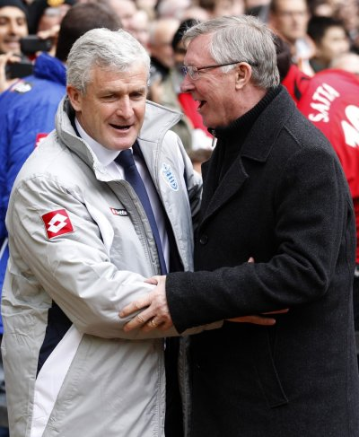 Manchester United039s manager Ferguson greets his Queens Park Rangers counterpart Hughes during their English Premier League soccer match in Manchester
