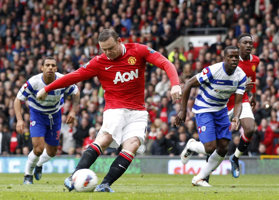 Manchester United039s Rooney scores a penalty against Queens Park Rangers during their English Premier League soccer match in Manchester