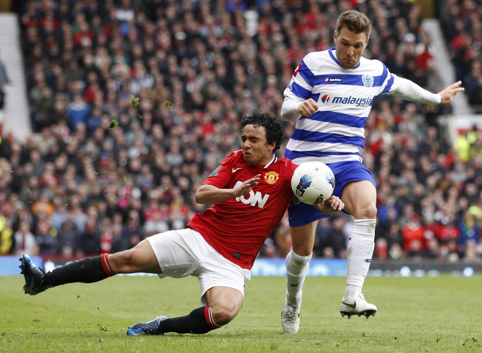 Queens Park Rangers039 Buzsaky challenges Manchester United039s Da Silva during their English Premier League soccer match in Manchester