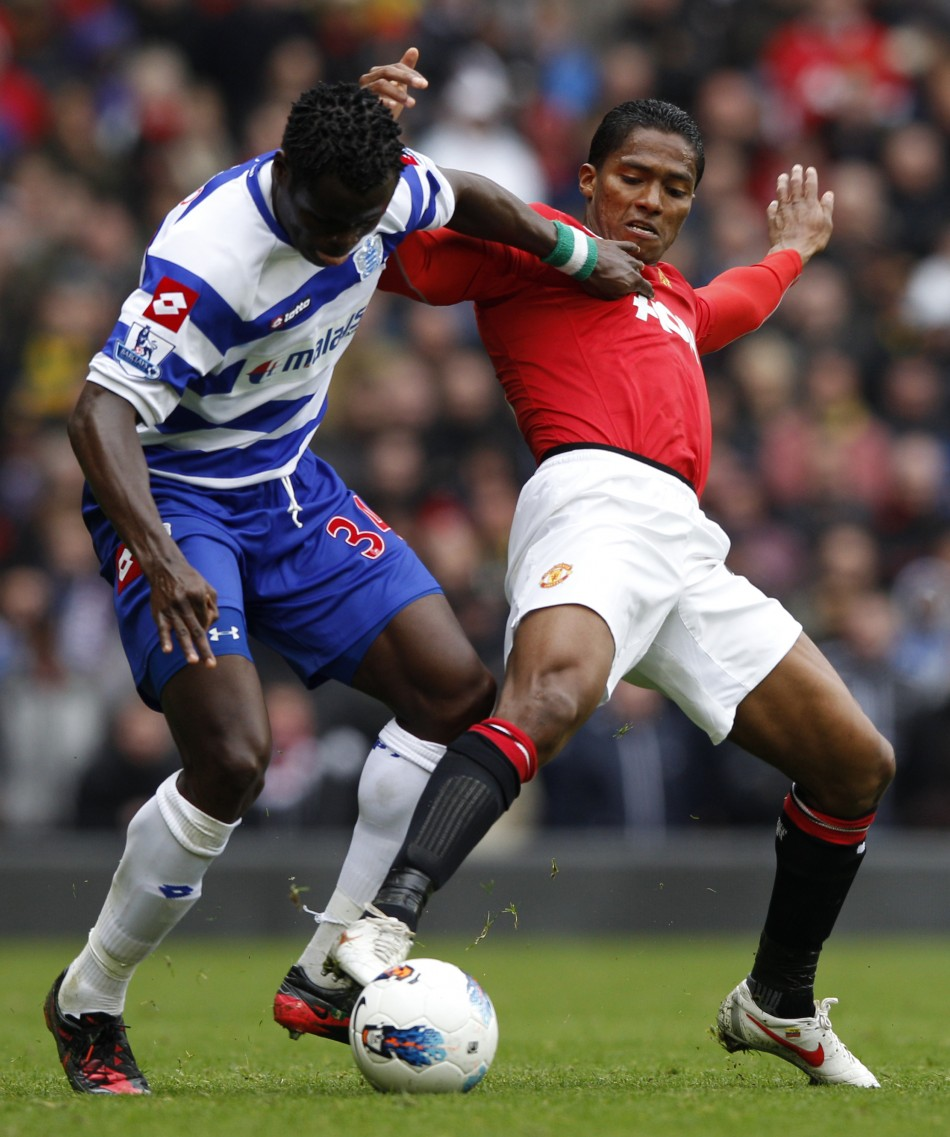 Queens Park Rangers039 Taiwo challenges Manchester United039s Valencia during their English Premier League soccer match in Manchester