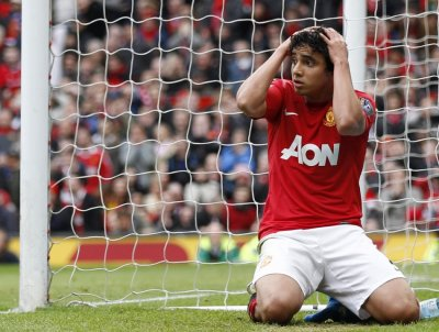 Manchester United039s Da Silva reacts after missing chance to score during English Premier League soccer match against Queens Park Rangers in Manchester