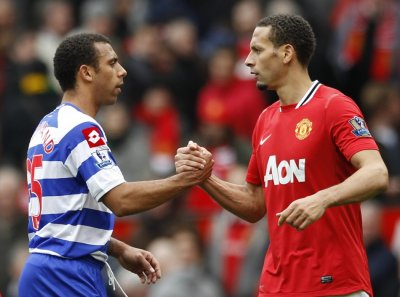 Manchester United039s Ferdinand shakes hands with Queens Park Rangers039 Ferdinand after their English Premier League soccer match in Manchester