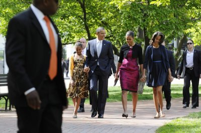 Obama and family walking to the church