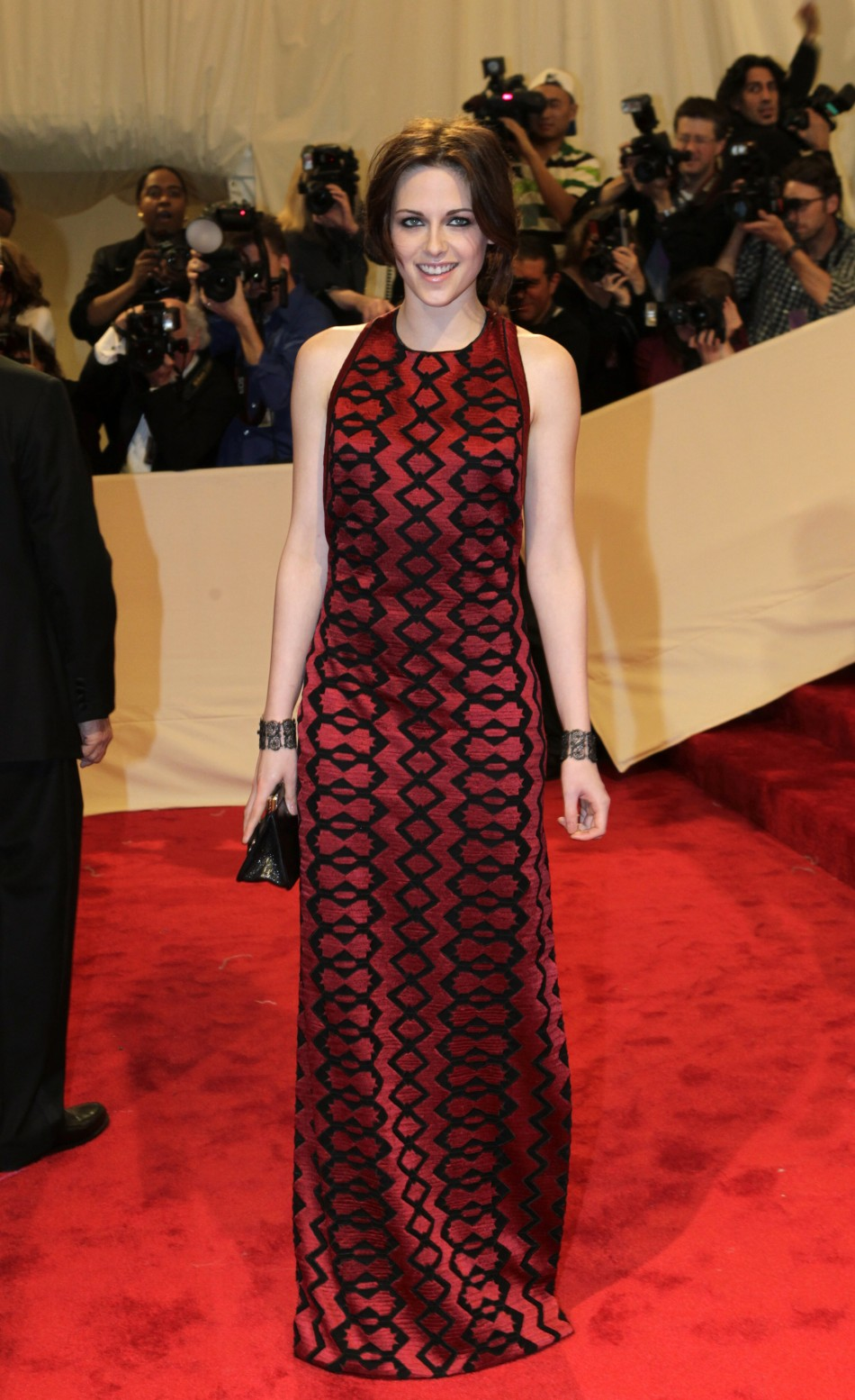 Actress Kristen Stewart poses on arrival at the Metropolitan Museum of Art Costume Institute Benefit celebrating the opening of Alexander McQueen Savage Beauty in New York