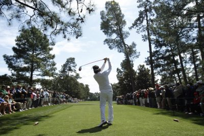 Watson of the U.S. hits his tee shot on the ninth hole during second round play in the 2012 Masters Golf Tournament in Augusta