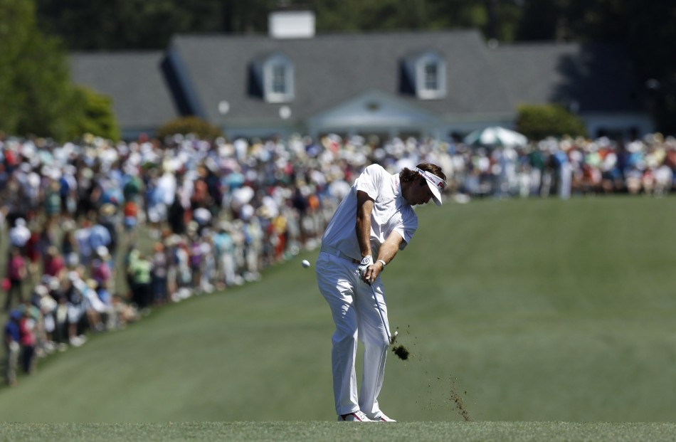 Watson of the U.S. chips to the first green during third round play in the 2012 Masters Golf Tournament in Augusta