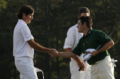 Watson of the U.S. shakes hands with Oosthuizen of South Africa after finishing their regulation round tied during final round play in the 2012 Masters Golf Tournament in Augusta