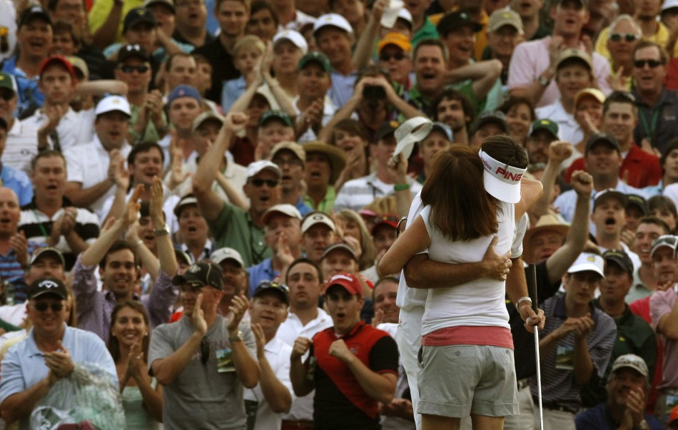 Bubba Watson of the U.S. hugs his mother Mollie after winning the the 2012 Masters Golf Tournament at the Augusta National Golf Club in Augusta