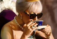 U.S. singer Lady Gaga sips a drink during a news conference in New Delhi