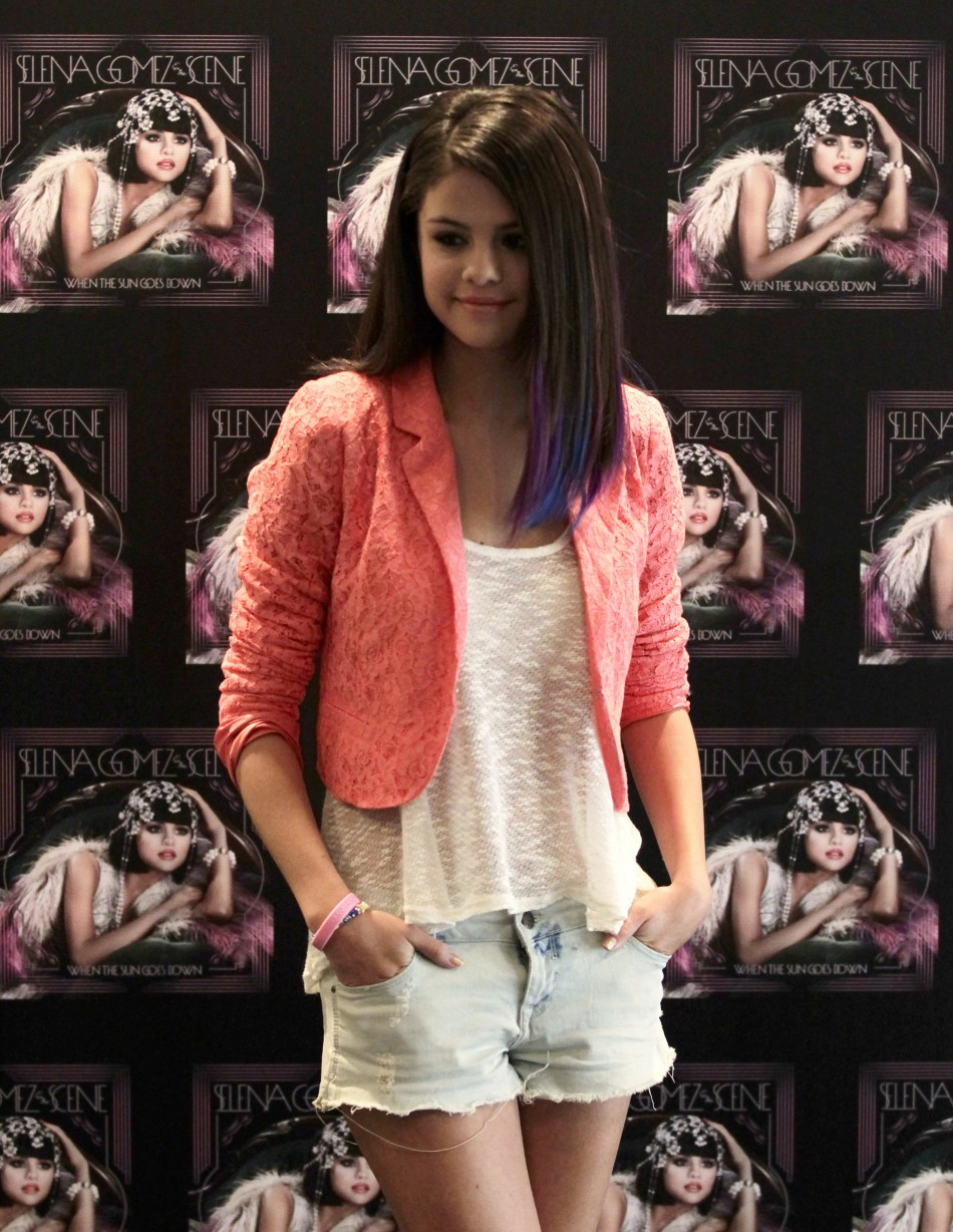 Actress and singer Gomez poses during a photocall before a news conference at a hotel in Mexico City