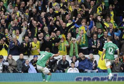 Norwich City039s Elliott Bennett celebrates with Norwich City fans after scoring against Tottenham Hotspur during their English Premier League soccer match at White Hart Lane in London