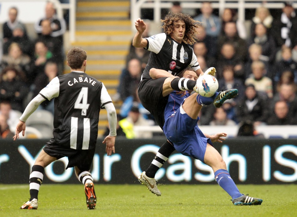 Newcastle United039s Coloccini tackles Bolton Wanderers039 Davies during their English Premier League soccer match in Newcastle