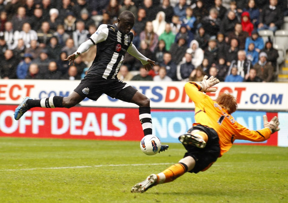 Newcastle United039s Cisse scores against Bolton Wanderers during their English Premier League soccer match in Newcastle