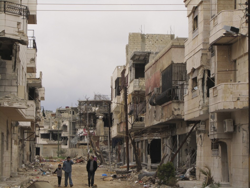 Houses damaged by the government army, according to the opposition, are seen in the Inshaat district of Homs