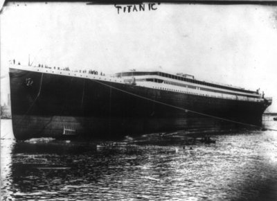 Titanic is launched into River Lagan for towing to fitting-out berth where her engines, funnels and interiors would be installed