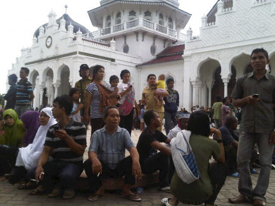 People gather outside the Baiturrahman mosque after an earthquake hit Banda Aceh
