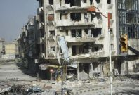 Buildings damaged in Homs from violence in Syria