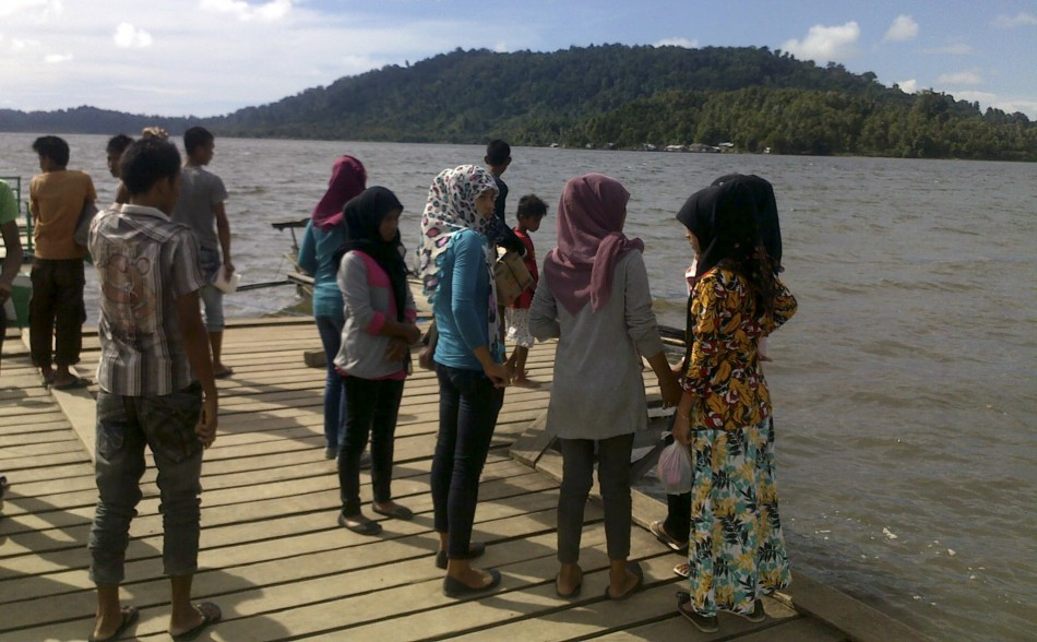 Residents gather at Sibigo bay to see water recede after an earthquake hit, on Indonesias island of Simeulue off Acehs southern coast