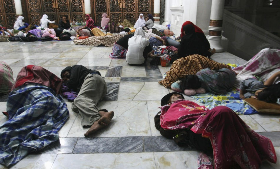 Residents sleep on the floor of Baiturrahman Mosque after an earthquake hit Banda Aceh