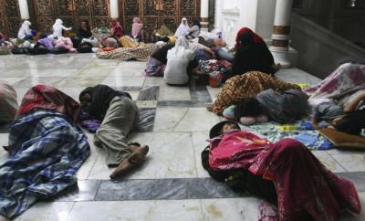 Residents sleep on the floor of Baiturrahman Mosque after an earthquake hit Banda Aceh