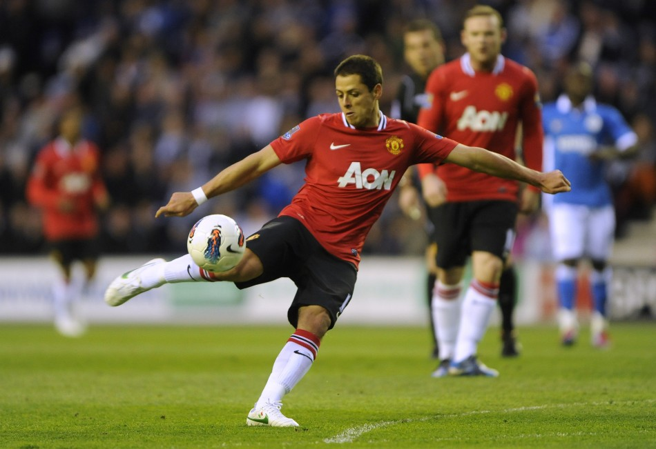 Manchester United039s Hernandez shoots against Wigan Athletic during their English Premier League soccer match at the DW Stadium Wigan