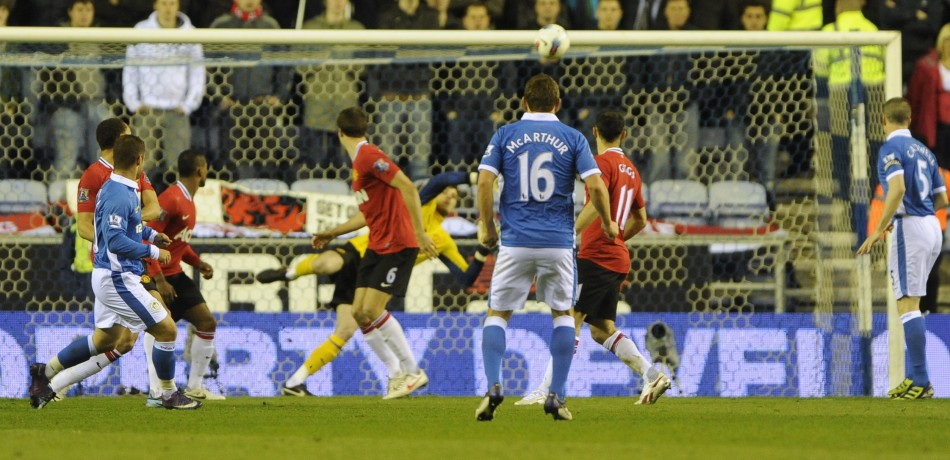 Wigan Athletic039s Maloney scores against Manchester United during their English Premier League soccer match at the DW Stadium Wigan