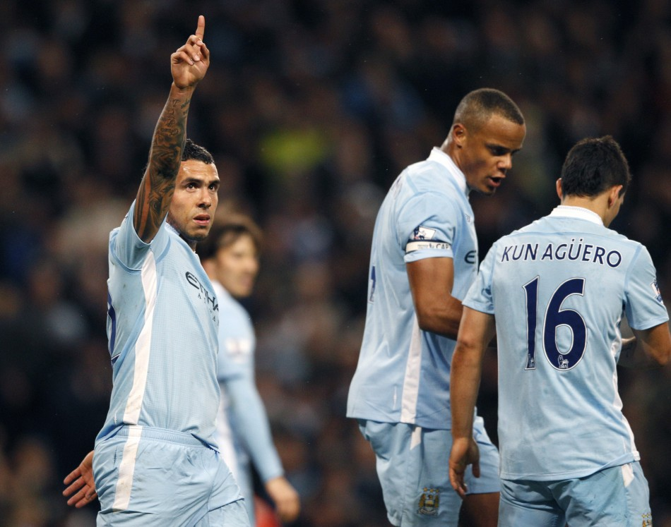 Manchester City039s Tevez celebrates his goal against West Bromwich Albion during their English Premier League soccer match in Manchester