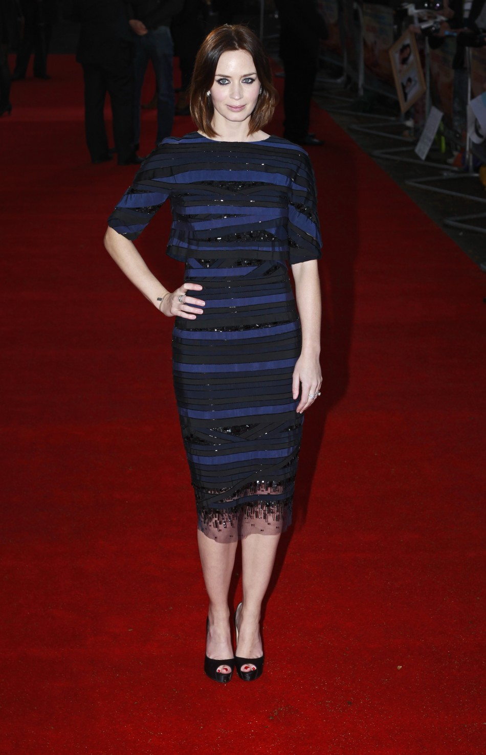 """Actress Emily Blunt poses for a photograph as she arrives for the European premiere of """"Salmon Fishing in the Yemen"""" at the Odeon Kensington in London"""