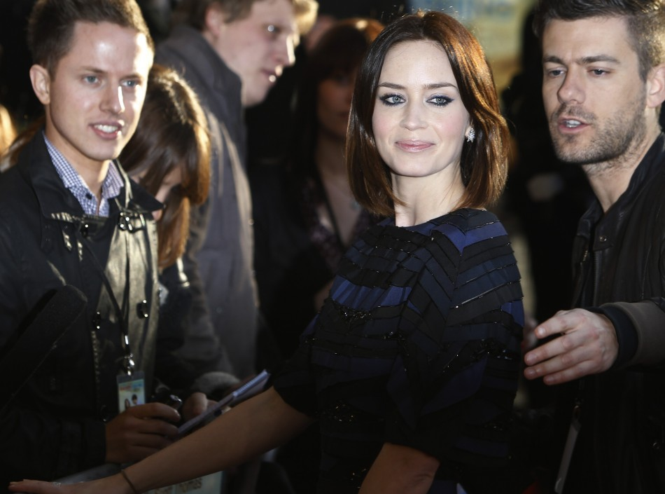 """Actress Emily Blunt waves as she arrives for the European premiere of """"Salmon Fishing in the Yemen"""" at the Odeon Kensington in London"""