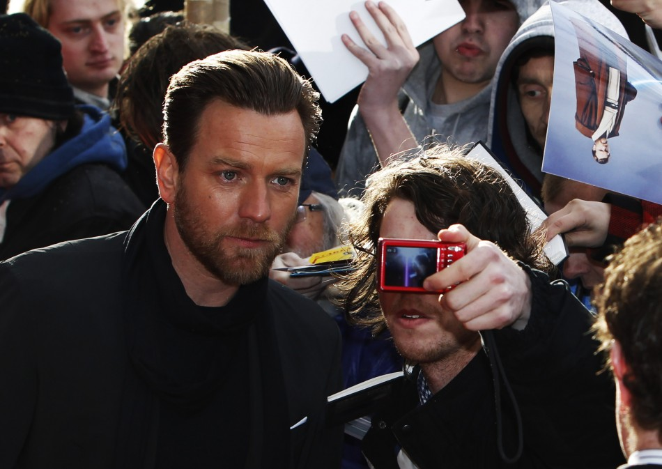 "Actor Ewan McGregor has a photograph taken with a fan as he arrives for the European premiere of ""Salmon Fishing in the Yemen"" at the Odeon Kensington in London"