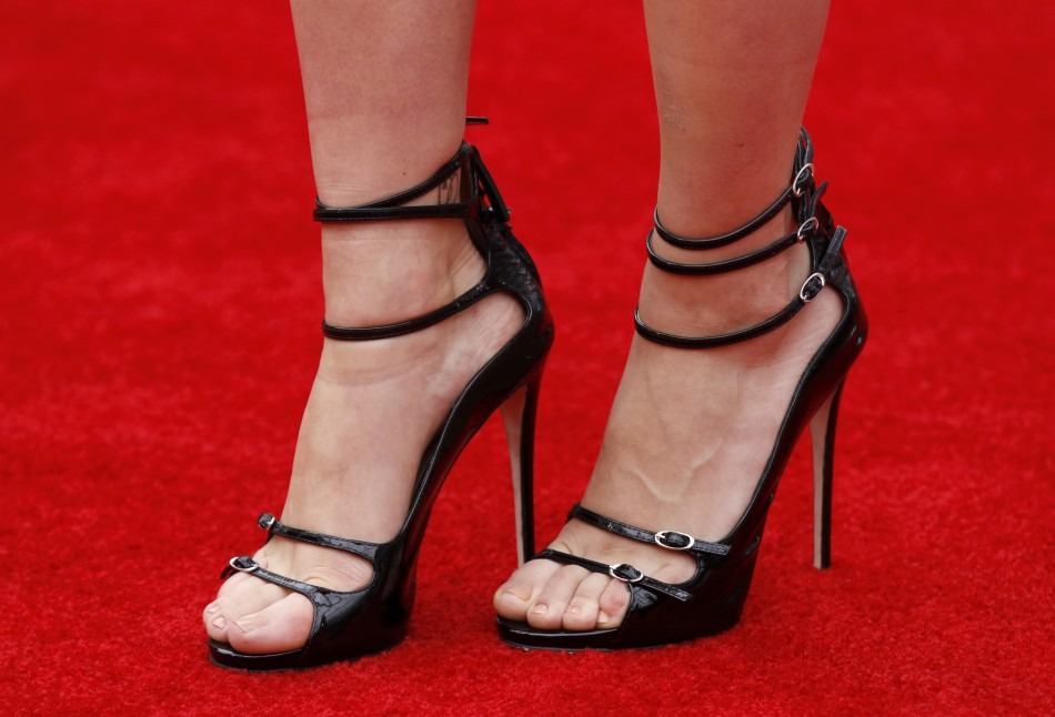 "The shoes of cast member Scarlett Johansson is seen as she poses at the world premiere of the film ""Marvel's The Avengers"" in Hollywood"