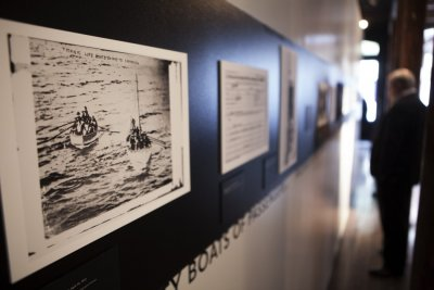 A photograph of lifeboats containing survivors from the sinking of the Titanic hang on the wall at an exhibit in the South Street Seaport Museum commemorating the 100th anniversary of the sinking of the Titanic in New York