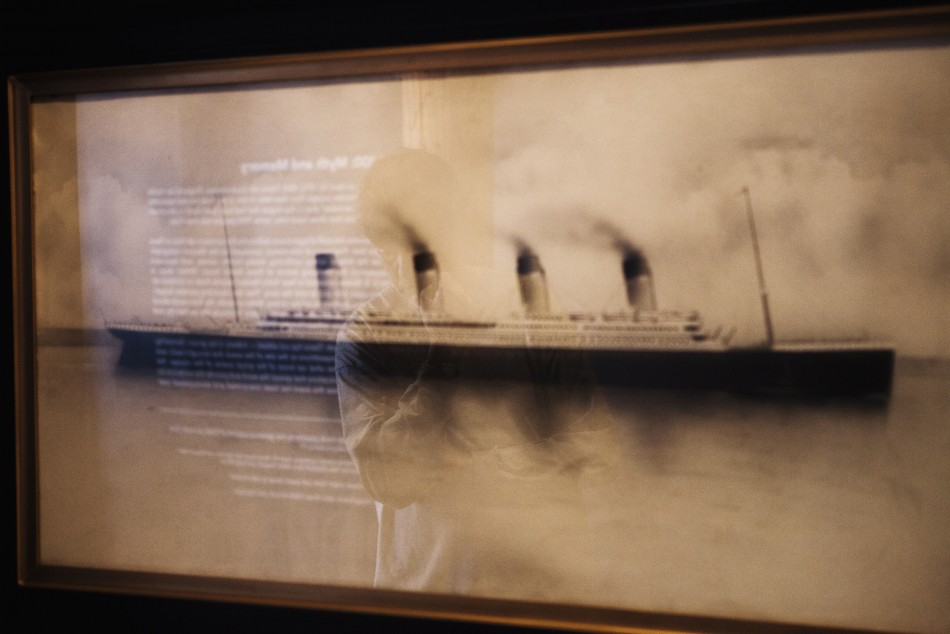 A patron stops to look at a drawing of the Titanic on the wall of an exhibit in the South Street Seaport Museum commemorating the 100th anniversary of the sinking of the Titanic in New York
