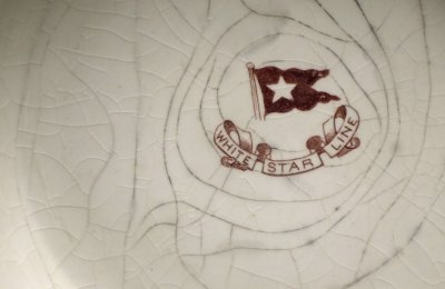 The White Star Line logo is seen on a bowl recovered from the wreck site of Titanic at the opening of a new exhibition at the Merseyside Maritime Museum