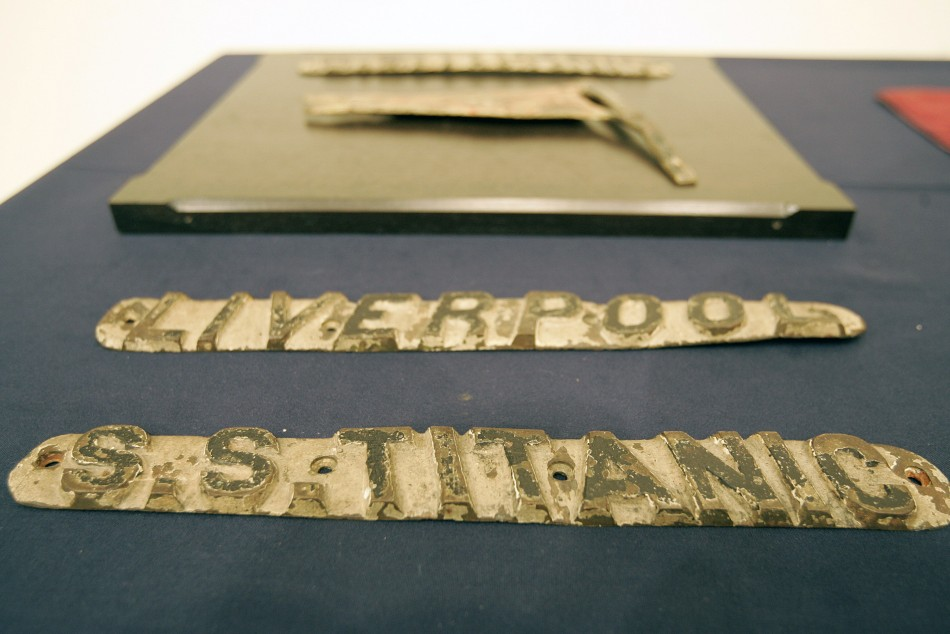 Cast bronze name board from Titanic cruise ships life boat sits on display at Christies in New York