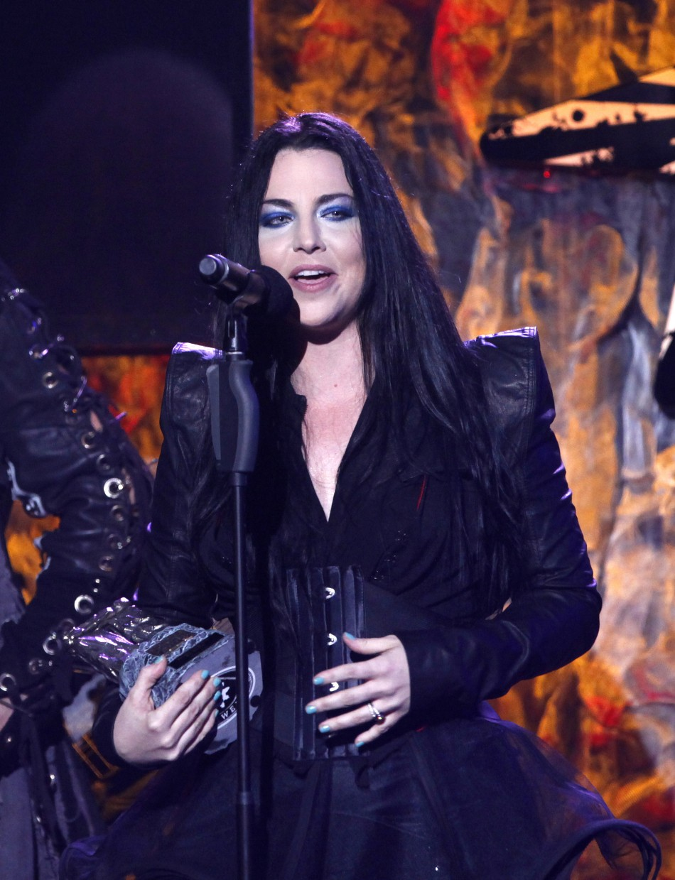 Singer Amy Lee of band Evanescence accepts the award for Best Vocalist at the fourth annual Golden Gods awards at Nokia theatre in Los Angeles