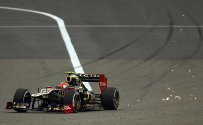 Sparks fly behind Lotus F1 Formula One driver Grosjean as he drives during the second practice session of the Chinese F1 Grand Prix at Shanghai circuit