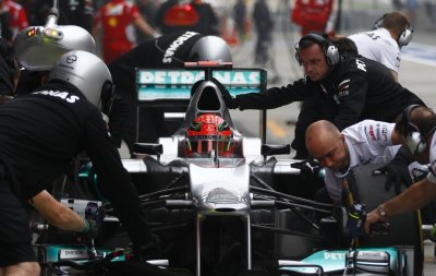 Mercedes team practices pit stops on Schumacher039s car during the second practice session of the Chinese F1 Grand Prix at Shanghai circuit